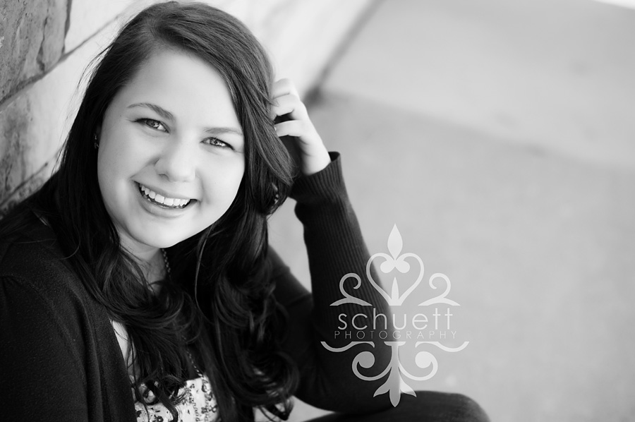 Black and white senior picture of a smiling girl in Milwaukee WI