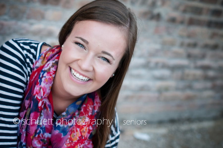Milwaukee senior picture with a bright colorful scarf and stripe shirt