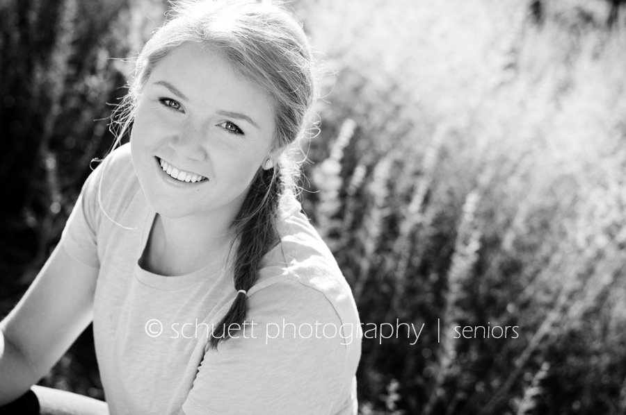 Black and white outdoor photography senior pictures with backlighting in Wisconsin